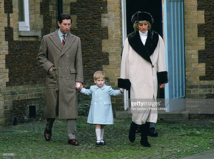 1988: Prince Charles, Prince Harry And Princess Diana Holding Hands As They Arrive For A Photocall At Sandringham. She Is Wearing Cashmere And Wool Coat With Synthetic Beaver Fur By Fashon Designer Arabella Pollen And A Fake Fur Hat By Milliner Gilly Forge. Prince Harry's Coat Designed By Fashion Designer Catherine Walker