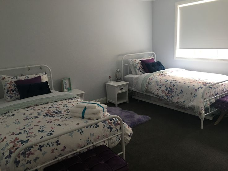 Girls bedroom, 2 x king single beds plus trundles. Butterfly linen from Adairs.