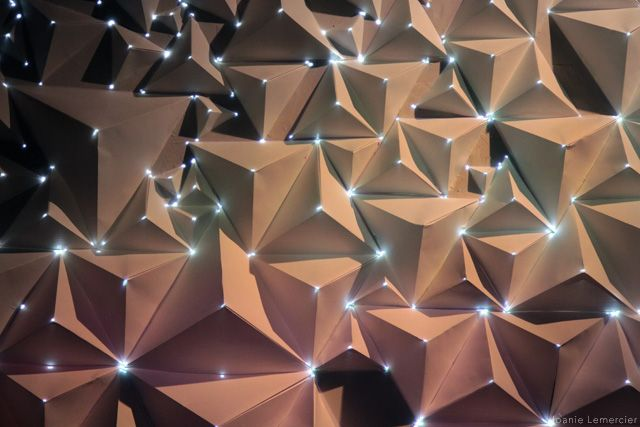 Bristol-based visual artist Joanie Lemercier has been experimenting with light projected onto 3D canvases. This lastest work created for a Birmingham gallery space was created using sheets of A4 paper folded into pyramids onto which he projected light resulting in an interesting organic effect.