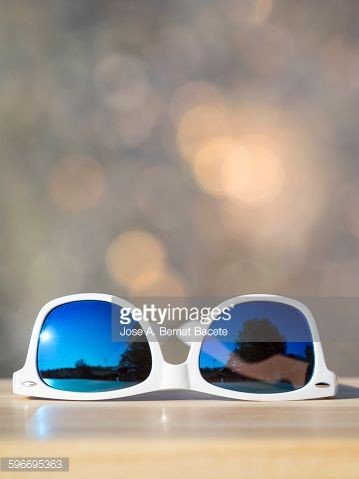 Stock Photo : Sunglasses on a table outdoors