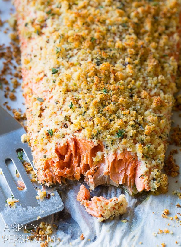Easy Oven Baked Salmon Recipe with Parmesan Herb Crust with only 6 ingredients! This tender flaky baked salmon recipe is topped with a crunchy herb crust.