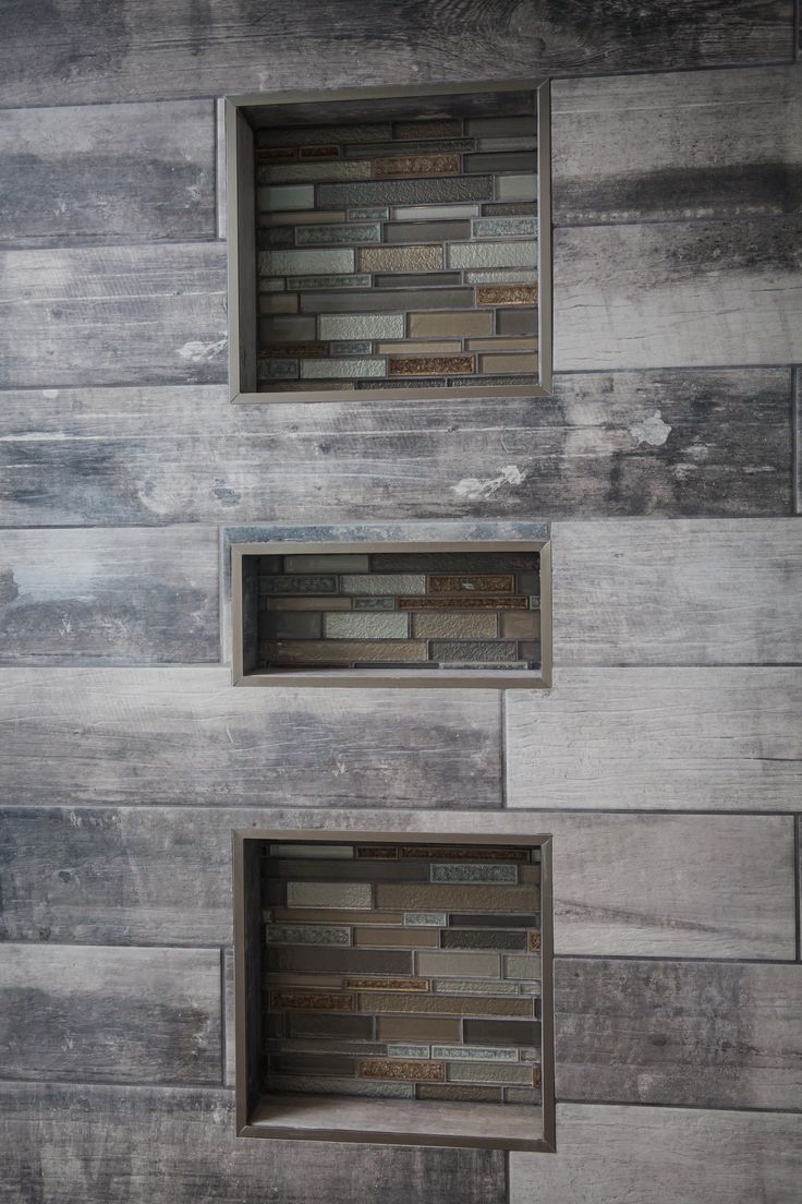 Amazing bathroom Walk in Shower featuring York wood manor tile color birch tree and Crystal Shores Random strip Mosaic from Dal tile granite bench with full enclosed glass walls home by Neuhaven Developments