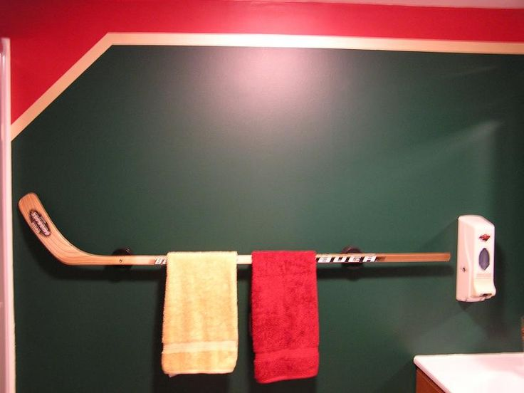 Custom hockey stick towel rack, perfect for your man cave or kids bathroom.  Part of a bathroom remodel in Inver Grove Heights MN