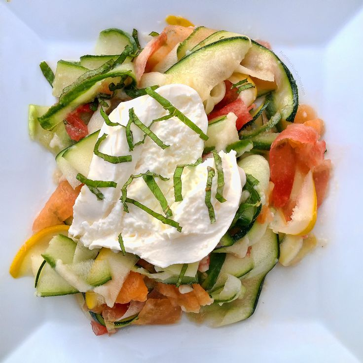 Summer salad with zucchini and melon ribbons and burrata & mint on top. Click for recipe.