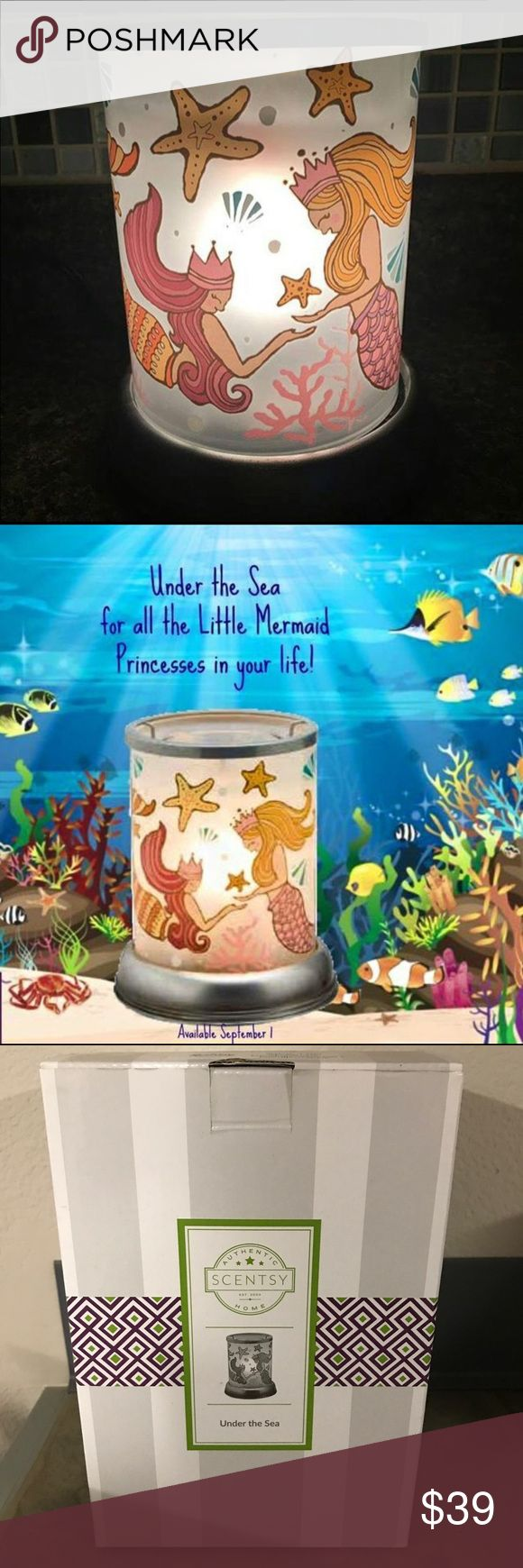 Scentsy under the sea mermaid candle wax warmer With a flip of her tail your little one will join the adventures all the mermaids are sharing when Scentsy's Under The Sea Warmer finds a home in bed or play room.  **wax not included scentsy Accessories
