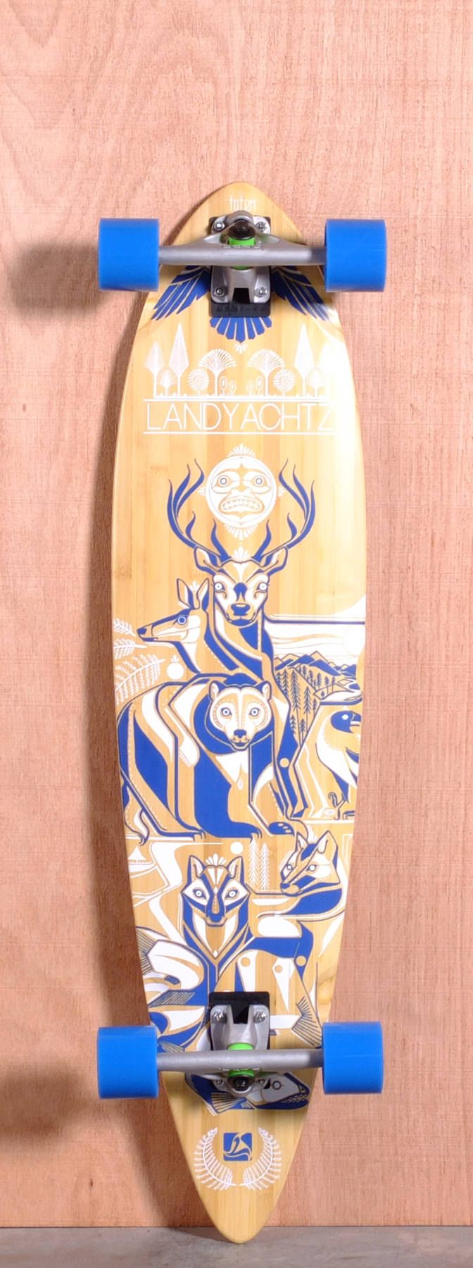 """The Landyachtz Fiberglass Totem Longboard Complete is designed for Cruising and Carving. Ships fully assembled and ready to skate!  Function: Cruising, Carving  Features: Medium W Concave, Rocker, Wheel Wells  Material: 5 Ply Vertically Laminated Bamboo, Fiberglass Core  Length: 41""""  Width: 9.9""""  Wheelbase: 27.75""""  Thickness: 1/2""""  Hole Pattern: Old School  Grip: Clear"""