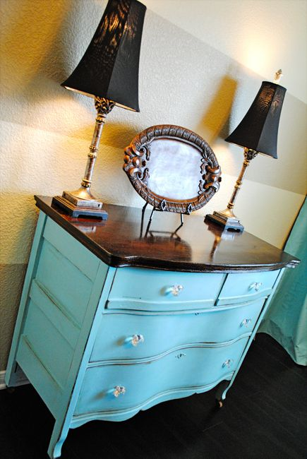 When refinishing a dresser, one option is to stain the top dark and coat with poly, but paint the rest of it.