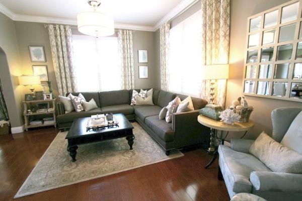 transitional living room. braemore trellis curtains. aqua coral art. taupe wall paint. custom media cabinet. drum pendant. by lucinda