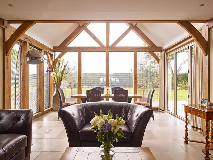 Open plan living is synonymous with modern homes and designing your home with an oak frame will achieve this. This beautiful oak frame lounge leads through to a beautiful glazed dining area allowing maximum natural light to flow through the room  #oakframe #oakframelounge #openplanlounge #gardenroom