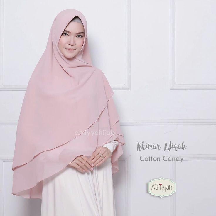 Athiyyah Hijab Khimar Afiqah Cotton Candy - hijab khimar jilbab kerudung pashmina syari Untukmu yg cantik syari dan trendy . . - khimar instan - pet kokoh dan lentur - pet anti tembem (antem) - dari bahan babydoll original GRADE A bahan bertekstur pasir bahan ini juga digunakan salah satu brand terkenal jadi kualitas bahannya tidak diragukan :) kecuali warna iris bahannya lebih kasar dibanding yang lain - jahitan halus dan rapih - keliling bagian bawah dijahit bukan dineci jadi lebih bagus…