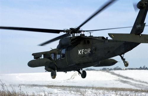 A US Army (USA) UH-60 Blackhawk helicopter takes off from the Heritage Drop Zone near Klina, Kosovo, after an airborne assault, in support of Operation JOINT GUARDIAN II
