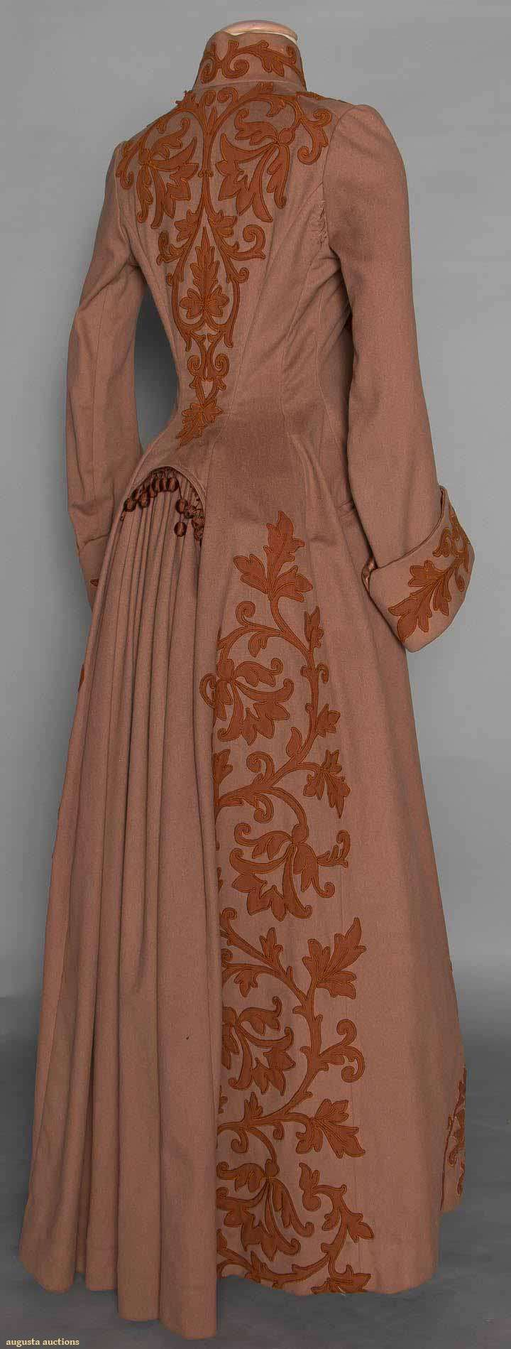 APPLIQUED WOOL BUSTLE COAT, c. 1888 | Cocoa brown, chestnut wool leaf & scroll appliques, high band collar, long fitted sleeves widen to deep cuffs, back fitted w/ gathered panel for bustle trimmed in baubles