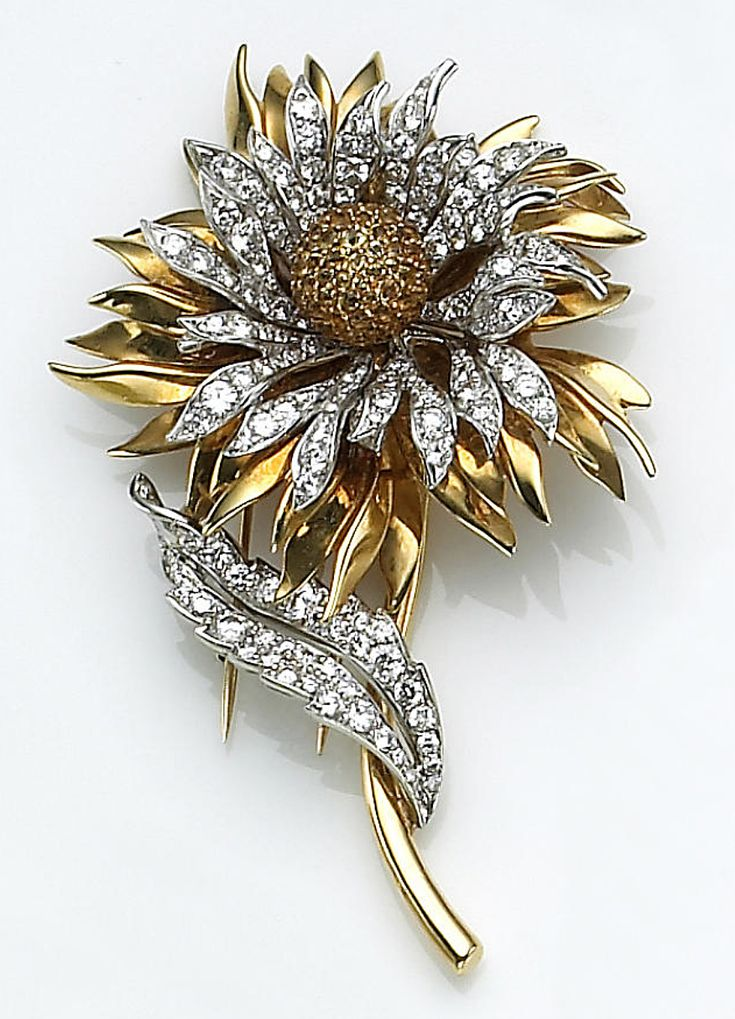 A diamond, yellow sapphire and eighteen karat gold flower brooch, Tiffany & Co. ...