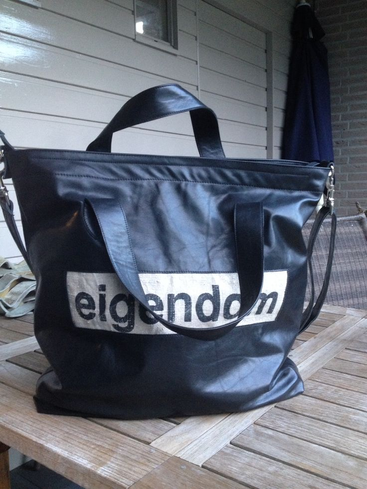 Big black leather bag, decorated with a piece of an old used Dutch postbag. Lining: sail of the sailboat.