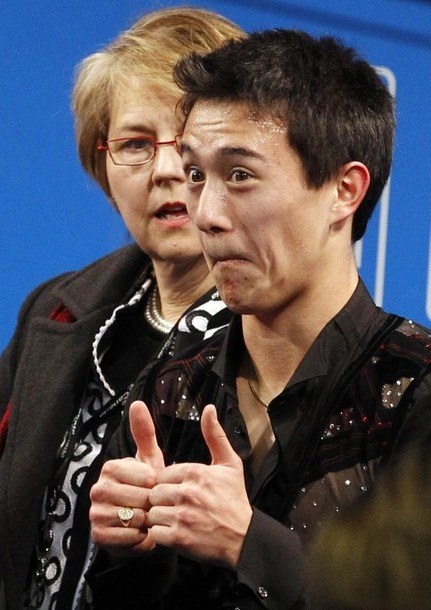 Patrick Chan with his former coach, Christy Krall, at the 2010 BMO Canadian Figure Skating Championships in London, Ontario, Canada.