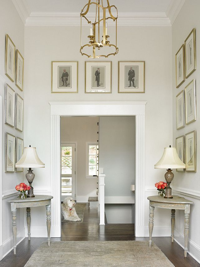 Classic Gray Benjamin Moore OC-23. Classic Gray has a bit more of a 'greyed-out' feeling to it than many whites while still holding a bit of a tan base. Benjamin Moore Gray paint Color. #ClassicGray #BenjaminMooreOC23 #BenjaminMooreClassicGray  Traditional Home.