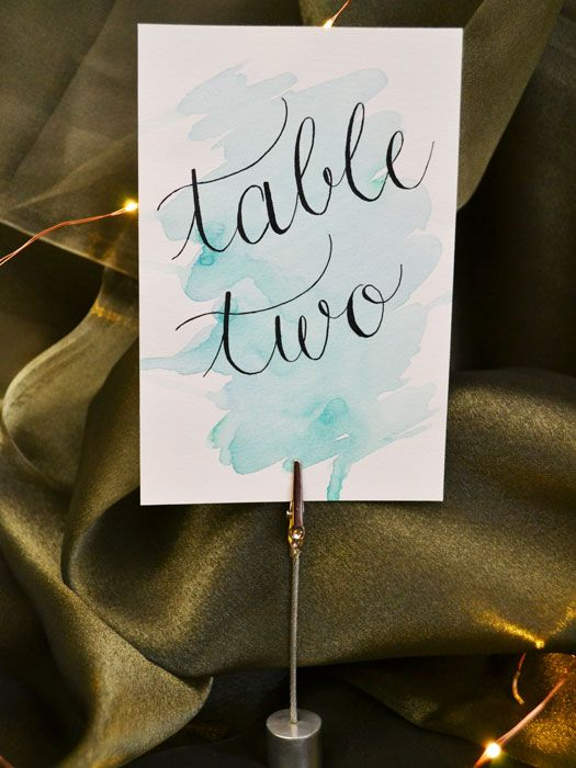 Handwritten calligraphy table numbers with a watercolor background. Wedding table decor. Calligraphy by The Elegant Quill. Sonoma County, California.