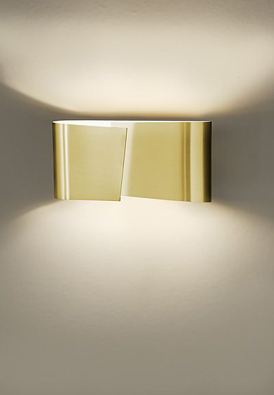 FILIA S Wall Sconce All wrapped up in brass - a modern wall sconce with an artistic flair. Filia S Wall Sconce, designed by 8|16 quergedacht, Cramer / Neveling for Holtkötter. Showing: UPC 848368068160 8531 BB BRUSHED BRASS