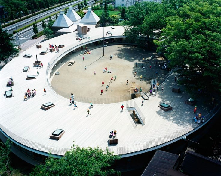Montessori School Fuji Kindergarten - Tokyo, Japan;  designed by Tezuka Architects;  an oval kindergarten building with a roof deck;  photo by Katsuhisa Kida