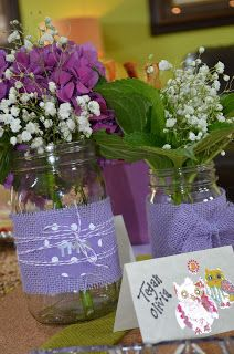 Mason jar centerpieces. Purple and green. Baby shower. Baby girl.