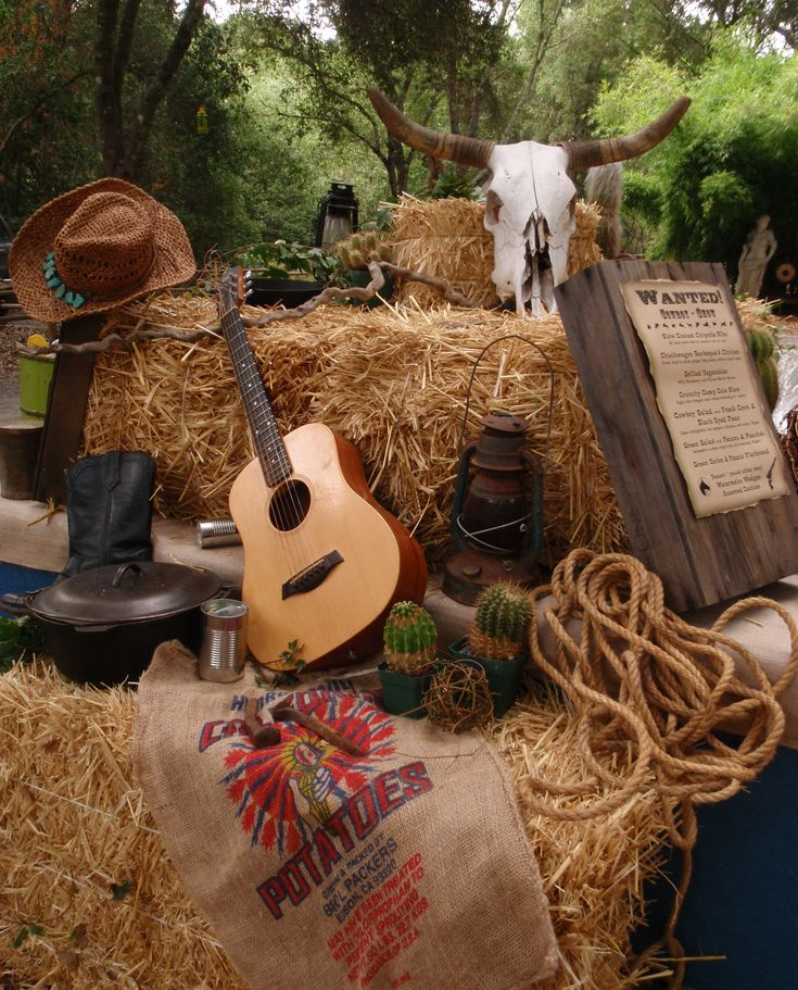 Western Theme must haves: Guitar, cowboy hats, rope, sacks, hay bales, wanted signs, lanterns, etc