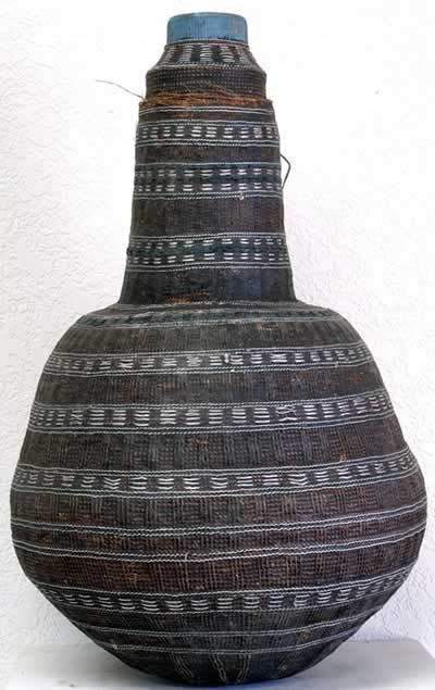 Borana Milk Vessel, Ethiopia  Gourd with twine, white metal/silver