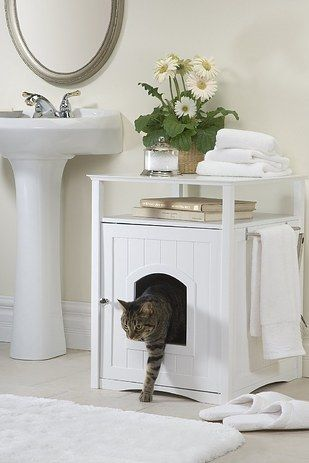Give your cat (or dog) some privacy and disguise the litter box with a nightstand/cathouse combo. | 37 Ways To Disguise The Ugliest Parts Of Your Home