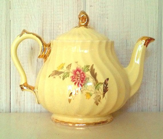 Rare Sadler teapot in a bright lemon yellow colour! Couldnt get the colour accurate on my camera - not a soft pastel yellow but a bright lemon yellow. No chips or cracks. Crazing around the bottom of the pot and on the inside (photo #4). Drip of yellow paint down the front of the teapot (photo #5). Holds approximately 4 cups. Made in England.