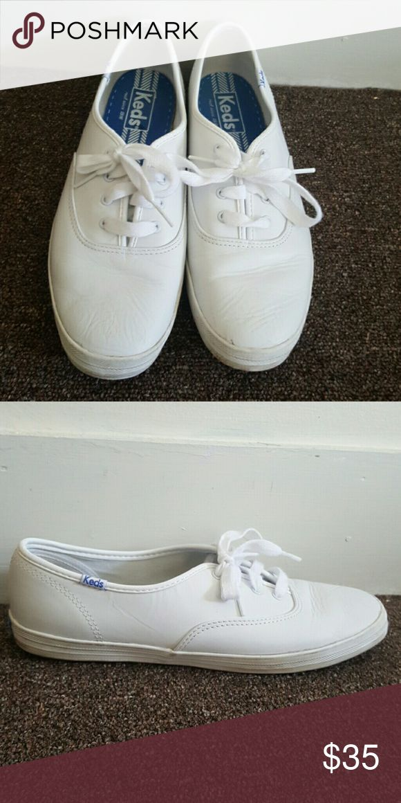 White Leather Keds I barely wore these however the leather has been wrinkled just a bit near the toes. I tried steaming them out but you can't even tell while you are wearing them. These are really cute and would even fit a size 10! I will clean out the small scuffs before I ship! Keds Shoes Sneakers