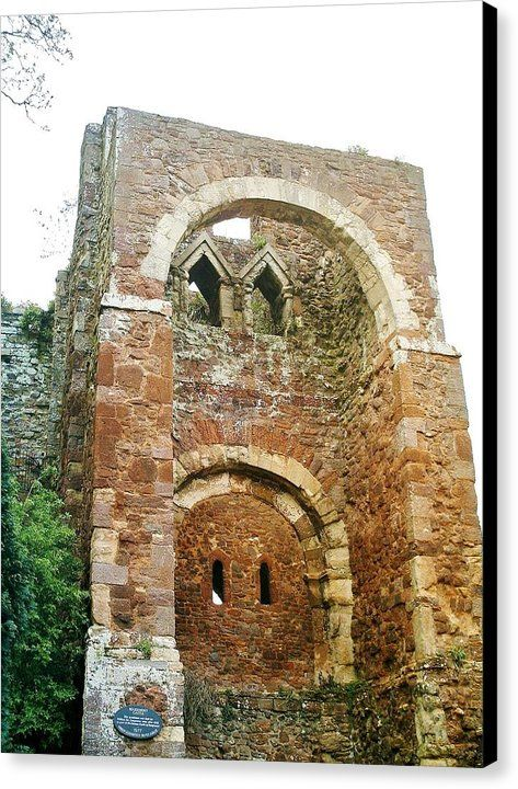 EARLY NORMAN GATEHOUSE ROUGEMONT CASTLE Canvas Print featuring photograph by Richard Brookes. DESCRIPTION: Enigmatic ruin of Norman gatehouse of Rougemont Castle, Exeter, Devon. Dating from c1068 it has Anglo-Saxon pointed upper windows & was built into the Roman Walls after Exeter's rebellion against William The Conqueror. Besieged by King Stephen in 1136, in Richard III by Shakespeare & where last 3 witches executed in England tried & sentenced in 1680s. Photo copyright Richard Brookes