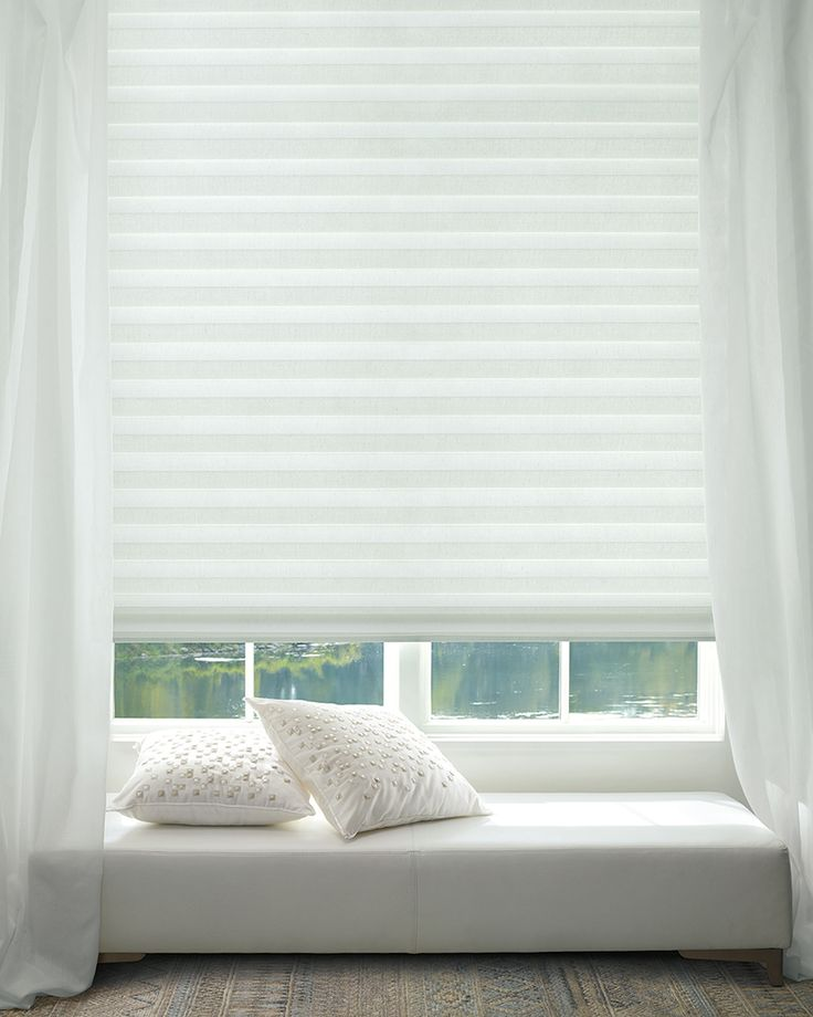 Create calm with a white design and Solera® Soft Shades. They are timeless, pure, and will transcend all styles.  ♦ Hunter Douglas window treatments #WindowSeat