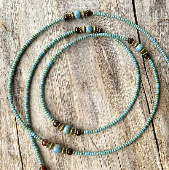 Glasses chain beaded eyeglass holder - Keep track of those fugitive reading glasses (or sunglasses) with this pretty and functional eyeglass lanyard. Delicate turquoise blue Picasso seed beads combine with larger aged blue picasso beads, clear coffee brown glass, and antiqued brass