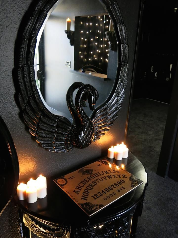 Blackcraft store. ~A black swan mirror. Above a Ouija board. Stylishly dark without being cliche. ~Hexotica