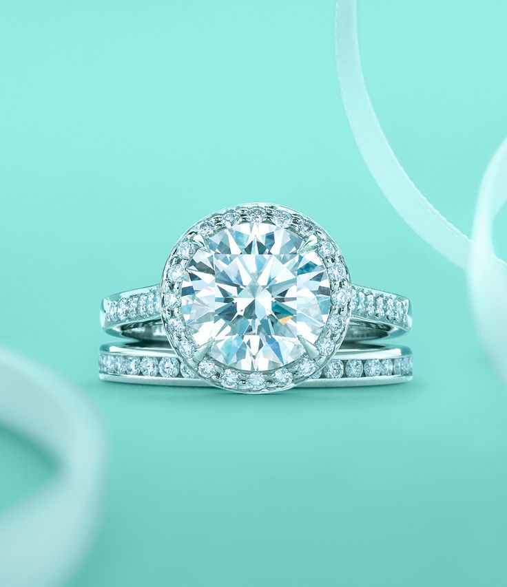 Tiffany Embrace® diamond engagement ring with a channel-set diamond band  ring. #