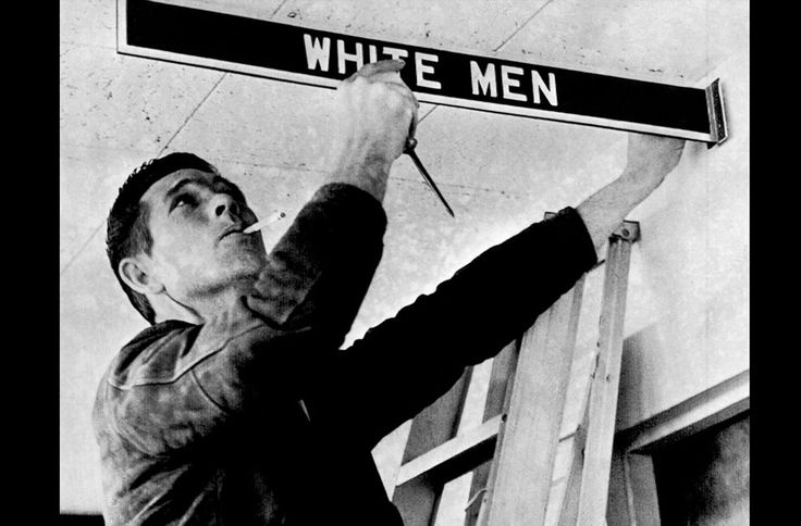 A workman removes a restroom sign at Montgomery Municipal Airport, on January 5, 1962, in compliance with a federal court order banning segregation. However, city officials delayed plans to remove waiting room furniture and close toilets and water fountains. But they said these and the airport restaurant will be closed if there is a concerted integration attempt.: Airports Restaurants, Court Order, Cities Official, Water Fountain, Room Furniture, Municipal Airports, Close Toilets, Restroom Signs, Federer Court