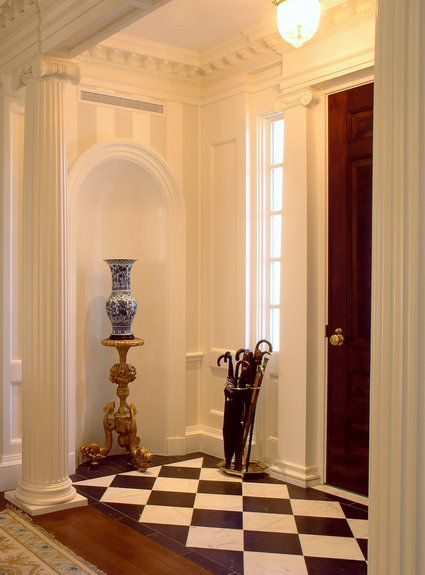 Entry use of harlequin tile or could paint wood to suggest harlequin tile on  floor in foyer.  Use of cove and pedestal with ornamental asian gourd vase at entryway.