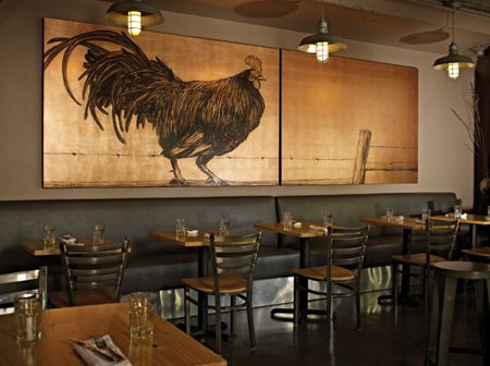 A rooster mural by Lynne Rutter crows cockily at Gilberth's Rotisserie and Grill in San Francisco, CA. The hand-painted oil on copper leaf diptych adds down-home warmth to the industrial-chic interior of the restaurant, which is built in an old cannery in the city's Dogpatch neighborhood. Photo: David Papas