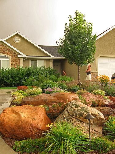 We spend so much watering our grass anyway I would love to do this with rocks and greenery in our front yard too!
