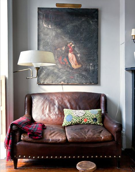 Raggedy old leather sofa. Brilliant for lounging with something good to read and loads of cushions!