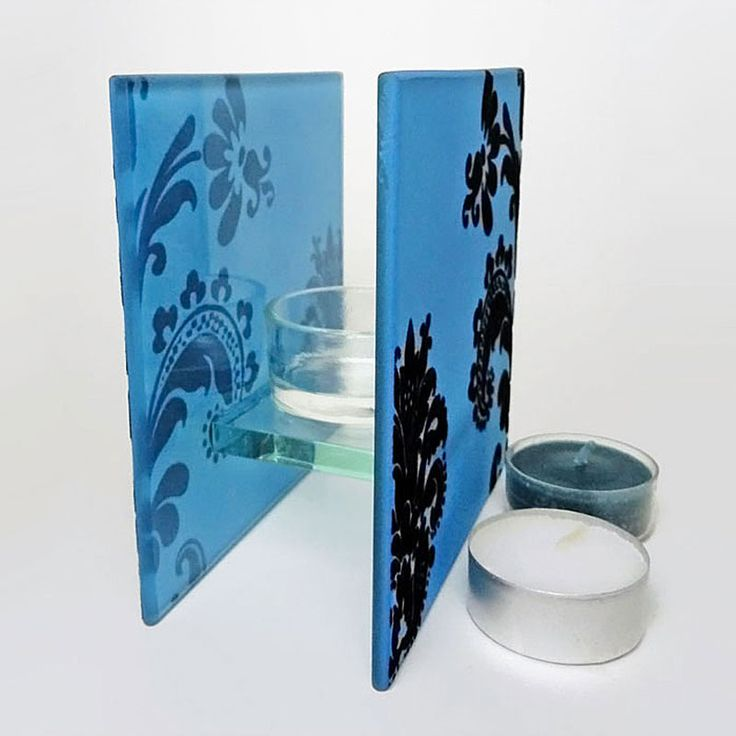 Blue Glass Square Tealight Candle Holder - CH241 - Blue frosty glass square tealight candle holder with dark velvet swirls. Tealight candle sits in a thick glass cup. Cup connects the two sides together. Beautiful home accent piece - in use or not. Uses no electricity. FOR SALE