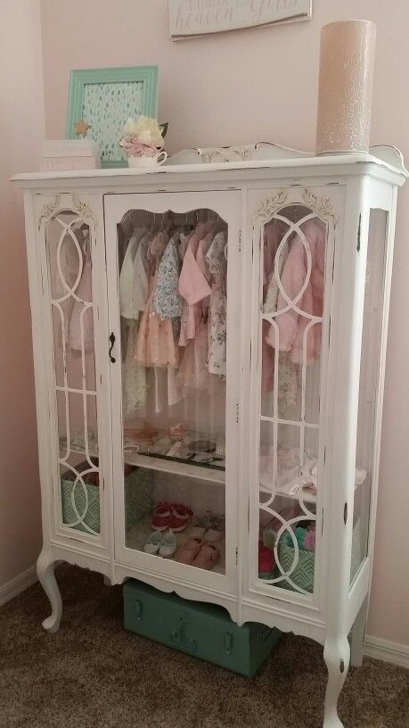 DIY - Repurposed China Hutch Displaying Little Girls Clothes...Great Addition to a Nursery! It's a Labor of Love Using Annie Sloan Chalk Paint. (Dress up storage?)