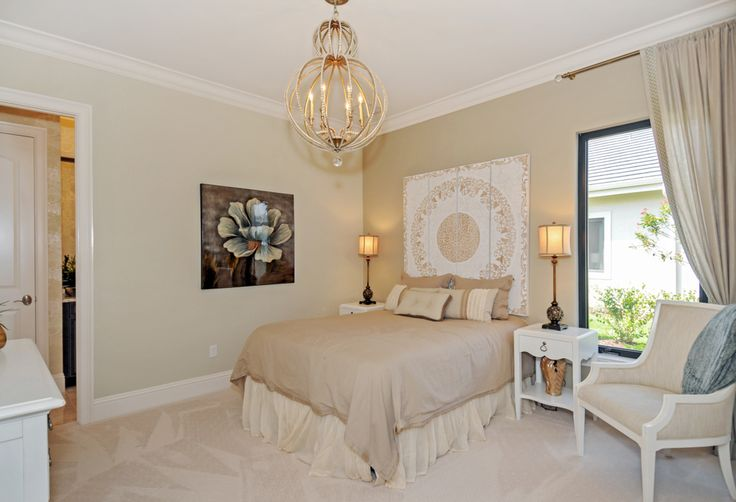 The home's color palette includes soft creams, golds and silvers with chocolate brown accents. Heavy textures and embroidered accents on the fabrics are mixed with walnut-toned furnishings and various metals.
