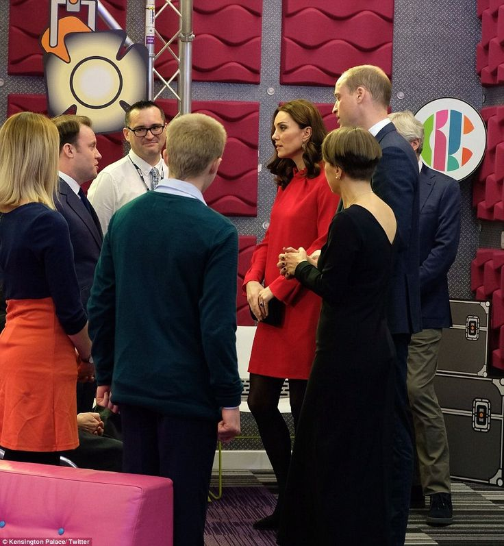 The Duchess of Cambridge looked to be getting into the festive spirit in a cheerful red dress by Goat as she visited Media City in Manchester