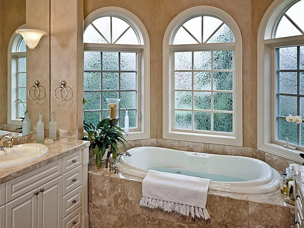 Use obscure glass for privacy in bathroom arched for Glass window design home