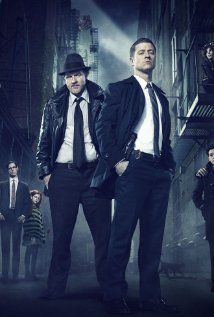 Gotham (2014) is a new series about a young Jim Gordon before he became police commissioner. This series begins with the murder of Bruce Wayne's parents. Besides a young Batman, other familiar characters include Harvey Bullock, Renee Montoya, Selina Kyle (Catwoman), Edward Nygma (Riddler), Oswald Cobblepot (Penguin), a young Poison Ivy, and Harvey Dent (Two-Face). There have been hints of the Joker but nothing concrete.