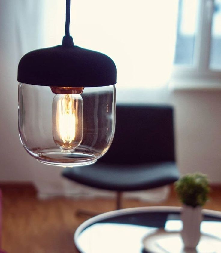 The unforgettable shape of the Acorn lamp lights up a dark morning in this image by @addesignum.