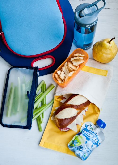 Lunch Menu #10- salami and cheese on a pretzel bun, blueberry smoothie, celery, pita chips, pear and water.