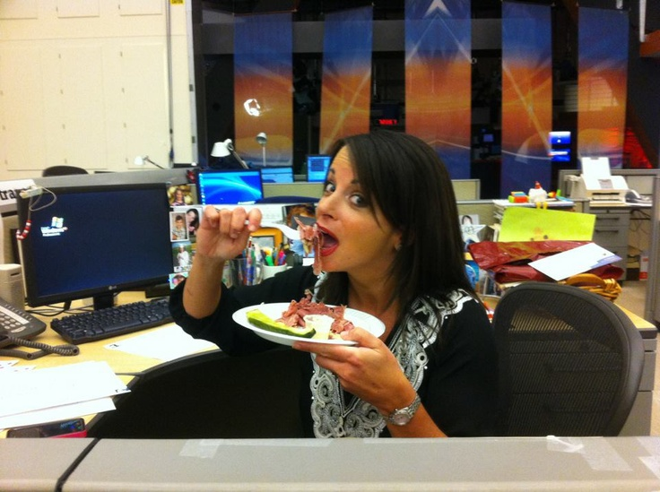 3/16/12 - Hollie digging in to Slyman's famed corned beef sandwich.