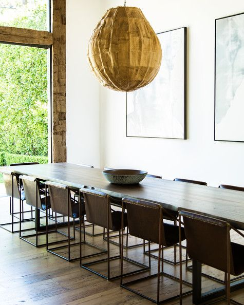 A large sculptural pendant lamp in Jenni Kayne's dining room.