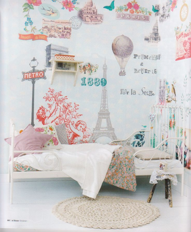 Paris themed girl's room. Love the wall paper and lady like bed #pink #travel #nursery